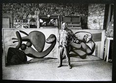 picasso-in-studio-with-canvases.