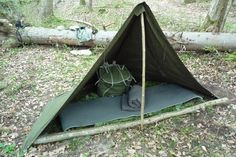 A simple half tent with bough bed