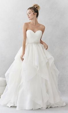 Style BE376, Ella Rosa A pleated bodice with ruffled skirt and belt detail.