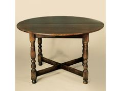 Holland & Co. Cottage Country Dining Tbl 48R shown in oak with one 18 in leaf, also available in walnut or cherry @Lee Jofa