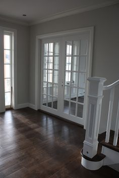 I love contrast. The dark floors with the light grey walls and white trim