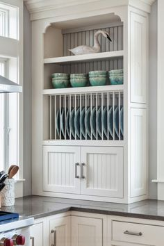 Nice kitchen dinnerware storage and display detail by REEF Cape Cod's Home Builder.