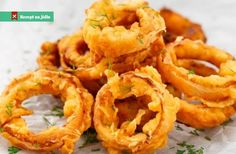 In the Spicy Indian Style Onion Rings the flavor of the onion rings is spiked up by using ginger, garlic and chilies. They are spicy, zesty and make a good addition to a chaat-party or tea party menu. Crispy Onions, Fried Onions, Tempura, Blooming Onion Sauce, Tea Party Menu, Onion Rings Recipe, Snack Recipes, Cooking Recipes, Drink Recipes