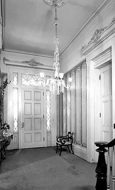The prominent doors and doorways of the first floor main entry hall all have Greek Revival narrow moldings and low pediments with decorative scrollwork. Moreover, each of the major rooms of the first floor has a wide, elaborate molded cornice and a large decorative plaster medallion in the middle of the ceiling.