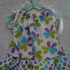 Sizes 3 mo to 4T. Purple, blue, green abstract flowers with polka dot ruffle!!