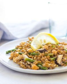 Spring Vegetable Farro Risotto | Farro is a hearty Italian grain that works great as a substitute for rice in this spring vegetable risotto recipe.  Farro has a chewier texture and nutty flavor compared to rice so it stand up well to bold flavors like tahini and lemon.  The leftovers are amazing as the flavors sit and get to know each other so make extra if you can. @sarahrae0920