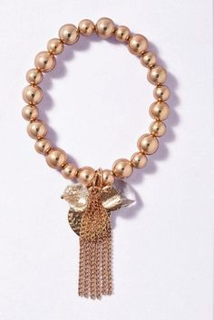 Buy Rose Gold Heart And Tassel Drop Ball Bracelet from the Next UK online shop