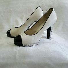 Chanel pumps Black and white cap toe pumps with a silver-tone heel, comes with dust bag CHANEL Shoes Heels