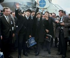 The Beatles arrive at New York's John F. Kennedy International Airport (formerly Idlewild), in New York. From left: John Lennon (waving), Paul McCartney, Ringo Starr and George Harrison. And the world was never the same...