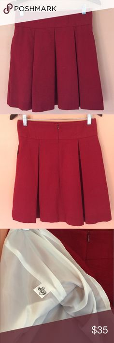Lauren James Seersucker Pleated Crimson Skirt-Med Great skirt to wear to those first hot football games! This skirt in this color (every size) is currently SOLD OUT and has been for several weeks. In like new condition, only worn once. Made in USA of 55/45 polyester/cotton blend and fully lined with static free lining. Even has on-seam side pockets...pop your phone in one and lipstick in other and you're ready to cheer your team to victory! Lauren James Skirts