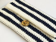 Navy and white striped cotton crochet clutch with golden anchor button