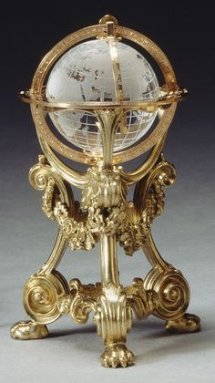 This globe was made in the workshop of Erik Kollin, Carl Fabergé's first Head Workmaster. It was purchased by Tsar Nicholas II on 31 December 1897 for 350 roubles and was subsequently owned by Prince Vladimir Galitzine, from whom Queen Mary purchased it on 16 December 1928. The rock crystal globe is geographically correct and swivels within its mounts. Mark of Erik Kollin; gold mark of 56 zolotniks and silver mark of 88 zolotniks (before 1896); Fabergé in Cyrillic characters Text adapted…