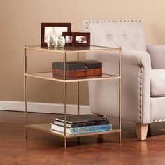 Go lavish in your living space with the Knox Side Table from Southern Enterprises. Opulent yet simple, it features minimalist architecture that contrasts perfectly with a luxurious metallic gold frame. High-shine mirrored shelves top the look. Unique Home Decor, Home Decor Items, Home Living, Living Spaces, Living Rooms, Home Interior, Interior Design, Glass Top End Tables, Glass Table