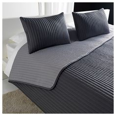 I have this bedspread in my son's room absolutely love it- KARIT Bedspread and 2 cushion covers - Queen/King - IKEA