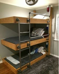 The triple bunk beds my engineer husband designed for our three sons who share a bedroom! It feels like a work of art in the room. As you can see from the pic, the bookshelf wasn't complete when I took the picture. We were able to find vintage explosion Bunk Bed Designs, Bedroom Designs, Triple Bunk Beds, Triple Bed, Kids Bunk Beds, Boys Bunk Bed Room Ideas, Bunk Bed Ideas For Small Rooms, Bunkbeds For Small Room, Murphy Bunk Beds
