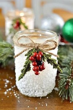 Christmas Snowy Mason Jar Cover the outside area of the jar with artificial snow (like the snowman sample above) then hang a winter berry. Pretty and elegant! Perfect for a candle holder!