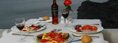 Dinner for two along with this view!    http://www.volcano-view.com/santorini-caldera-restaurant.php