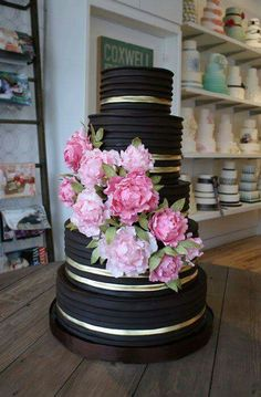Black buttercream wedding cake with pink flowers
