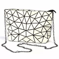 KAISIBO Geometric Women PU Leather Chain Crossbody Bag Size: Length: Height: Width: Please allow differences due to manual measurement. Colour: -Luminous, Rainbow, Black, Pink, White HHigh-quality material: -Made of High-Quality PU Leather -Inner Lining w Leather Chain, Pu Leather, Flower Bag, Chain Crossbody Bag, Clutch Purse, Plaid, Types Of Bag, Famous Brands, Shoulder Handbags