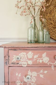 Bring a touch of spring into your home with a dresser painted pink and a simple display of glass bottles and branches. | Shades of Blue Interiors #shabbychicbedroomspink #shabbychicdressersblue