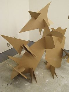 cardboard sculpture cardboard - I could turn this project into a lesson on shape and form. each student could cut out a shape from the cardboard, and then together collaborate to fit them together into a form. Sculpture Lessons, Sculpture Projects, Sculpture Ideas, Cardboard Sculpture, Cardboard Art, Art Carton, Classe D'art, School Art Projects, Collaborative Art