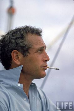Paul Newman, Smoking, wearing Brooks Brothers OCBD, collar unbuttoned. 1967.