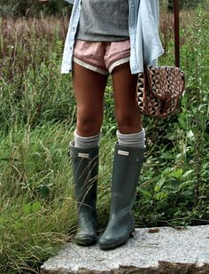 Rain boots, tall socks. Wear with black skirt, t-shirt and button up/sweater