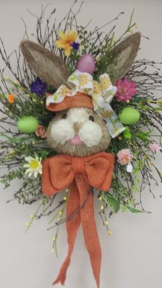 Here comes Peter Cottontail!  #ShopSmall & enjoy beautiful one-of-a-kind wreaths and arrangements created by our in-house designer when you visit The Gift Shop at Hinkle's!! #Easter #spring #wreath #arrangement