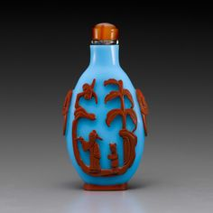 A red-overlay blue-glass bottle  19th century