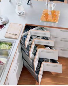 7 Corner Drawers And Storage Solutions For The Modern Kitchen Storage Ideas The concept of corner drawers in your bedroom furniture can be deceiving to some people. Many people think of these drawers as being nothing more than. Smart Kitchen, Kitchen Tops, New Kitchen, Kitchen Ideas, Kitchen Corner, Updated Kitchen, Kitchen Layout, Best Kitchen Designs, Modern Kitchen Design