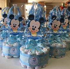 These adorable diaper cake centerpieces come with a balloon and 18 diaper (Huggies little snugglers size 1). I can make your cake in any color and for any theme, The Mickey is made card paper. I make my diaper cakes and other products in sanitary conditions inside my home, so you can use them on your baby with peace of mind. Visit my web page to see corsages you can give to your guests. Whatever your partys theme, I can create corsages and cakes to go with it. (Included white paper doilies)…