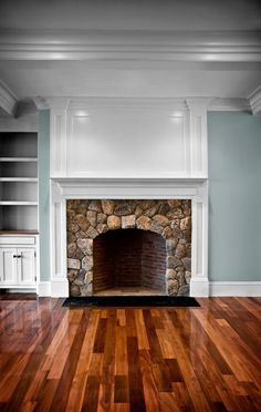 stone fireplace with moulding above