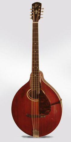 Gibson K-2 Model Carved Top Mandocello (1914), made in Kalamazoo, Michigan, serial # 29539, sunburst top, dark cherry stained back and sides finish, birch back and sides, spruce top; mahogany neck with ebony fingerboard.