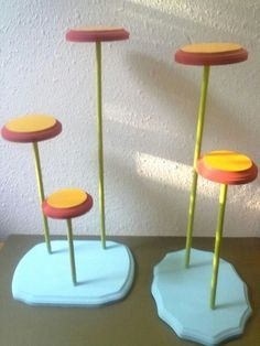 How to Make a Hat-Stand for Less Than Ten Bucks. This would be a great idea for the top shelf in my closet, using shorter dowels. We have so many hats.