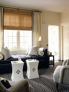 Love the real smooth drapes over the textured natural roman shade.  Juxtaposition, anyone?