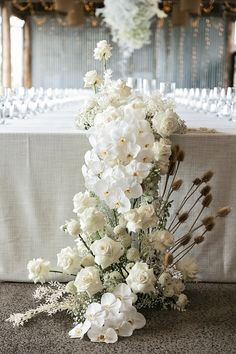 Modern White Wedding Style with Babies Breath, Phalaenopsis Orchids, Roses and Dried Flowering Filler White Wedding Arrangements, Flower Arrangements, Flower Centerpieces, Love Birds Wedding, Floral Wedding, Rustic Wedding, White Roses, White Flowers, Hanging Clouds