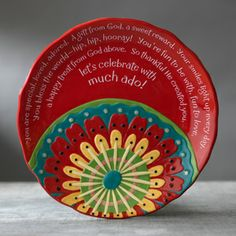 """Celebrate Plate, 12"""" diameter. Message reads: You are special, loved, adored. A gift from God, a sweet reward. Your smiles light up every day. You bless the world—hip, hip, hooray! You're fun to be with, fun to love, a happy treat from God above. So thankful He created you—let's celebrate with much ado! The beautiful Scripture on the underside of the plate reads, He will take great delight in you, He will rejoice over you with singing. ZEPH 3:17 NIV.  Microwave and Dishwasher safe. Price…"""