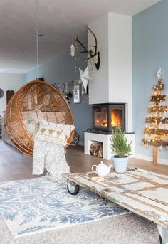 Living room with Christmas decor and hanging chair
