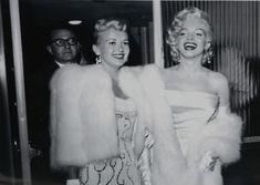 Marilyn Monroe & Betty Grable emerge from a restaraunt circa 1953