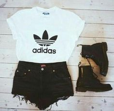 .white addias shirt with black shorts and shoes