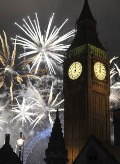 As Big Ben tolls, signaling the beginning of a New Year, the U.K.'s largest annual fireworks display takes place at the London Eye.