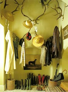 Staggered antlers add a rococo flourish to this mud room.