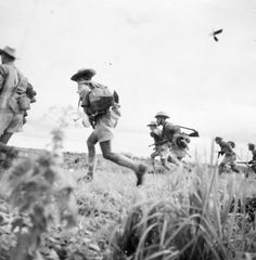"""Skirmishers from 5th company 2nd Battalion of March, 1st RTA advance to recapture the outcrop at Ninh Binh, support being provided by aircraft from 3rd Dinassault, platoon """"Auffret"""" 1RCC, a battery of 64th RAA and a section of 6th RTM"""