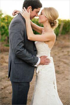 bride and groom captured by Ken Kienow Photography #brideandgroom #weddingphotography #weddingchicks http://www.weddingchicks.com/2014/03/17/shabby-chic-winery-wedding/