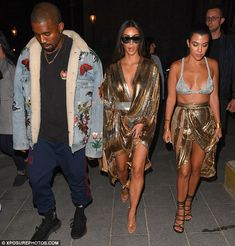 Time to go: Kanye, Kim and Kourtney are shown leaving the Balmain afterparty in Paris