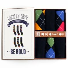 Argyle Men's 6 Sock Gift Box  Preppy argyle and classically bold colors on black, make this men's 6 single sock gift set a sweet treat for his feet! It's perfectly packaged in this uniquely fun brown box, and ready to be gifted to any dapper dude #giftsfordad #funkysocks