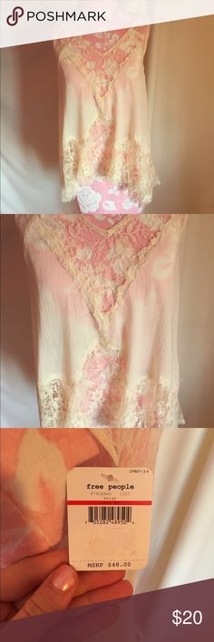 Free People cream lace top *New Free People Lace Top that is new with tags! *cream *says XS, but fits up to a size medium (that's what I am hehe) Free People Tops Tank Tops