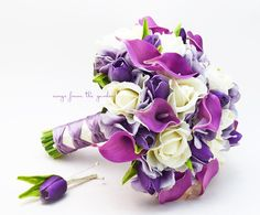 White Real touch roses with Real Touch purple calla lilies, silk hydrangea in lavender and Real Touch purple mini tulips create a lovely flower bridal bouquet that can be yours to have & to hold on yo