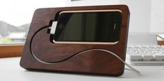 One of the classiest looking iPhone stand you can buy  http://news.cnet.com/8301-17938_105-57396303-1/meet-the-stylish-basestation-for-iphone-4-dock/