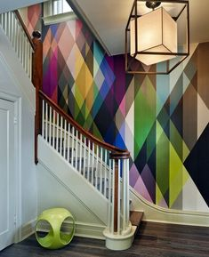 Geometric wall with traditional staircase... this is a good one both in terms of color and harmoniousness despite complications in the composition